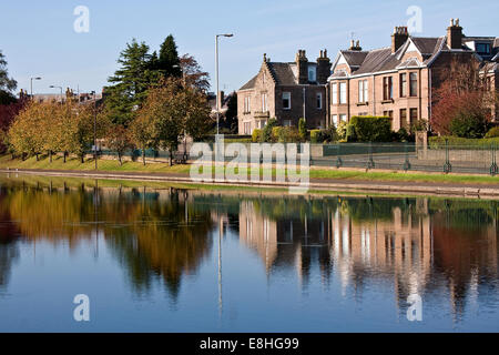 Crisp colourful Autumn reflections on Swannie Pond in Dundee, UK - Stock Photo