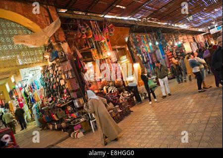 Horizontal view of people walking through the souks of Marrakech. - Stock Photo