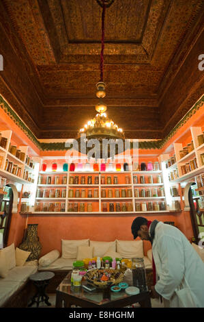 Vertical interior view of an apothecary, aka Berber chemist, shop in the souks of Marrakech.