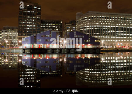 Reflections in water of the various buildings in London's Canary Wharf Financial District. - Stock Photo