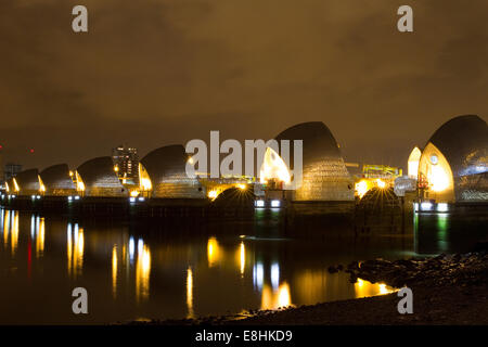 Thames Barrier at night as seen from New Charlton in the Royal Borough of Greenwich. - Stock Photo