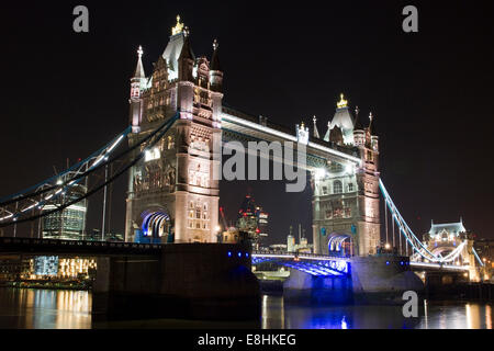 Tower Bridge at night with 20 Fenchurch Street, The Gherkin and the Tower of London all visible. - Stock Photo