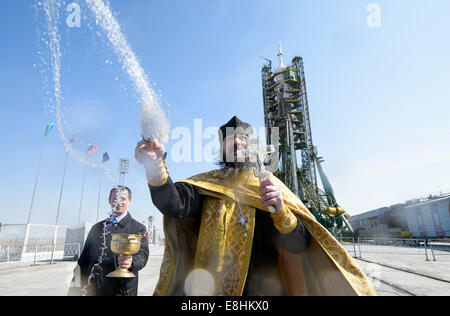 An Orthodox priest blesses members of the media on the Soyouz launch pad at the Baikonur Cosmodrome launch pad on - Stock Photo