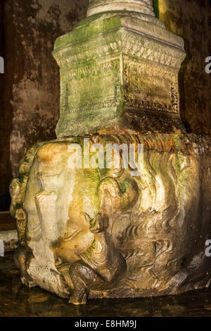 Medusa head at the complex of columns and water underground, basilica cistern, Istanbul, Turkey - Stock Photo
