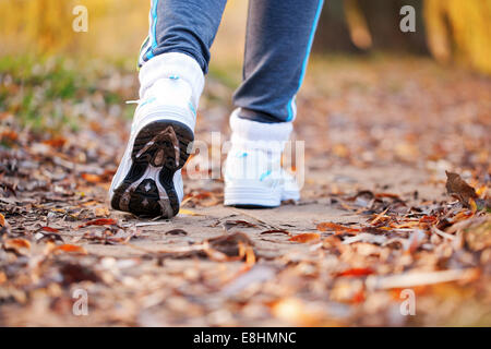 Close-up running feet in trainers of female runner. Healthy lifestyle, fitness, jogging, active, young concept. - Stock Photo