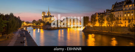 Cathedral Notre Dame along the banks of River Seine, Paris, France - Stock Photo