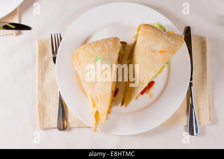 Overhead of Sandwich on Square Ciabatta Bun on Plate at Restaurant Place Setting - Stock Photo