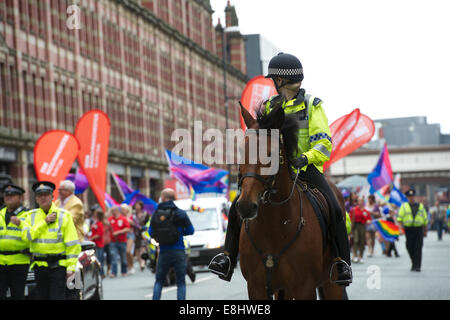 Mounted Police Officer looks back on the Parade as she marshals the Pride March, Manchester. - Stock Photo