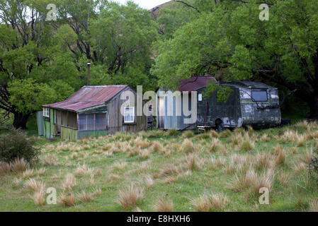 A little place in the country - old house, outhouses, long-drop dunny and caravan. Known locally as a Bach or Crib. - Stock Photo