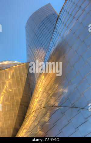 Early morning light reflects off the facade of the Frank Gehry designed Peter B. Lewis Building in Cleveland, Ohio. - Stock Photo