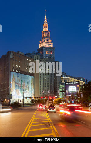 Rush-hour traffic creates light trails heading for the downtown area and the Terminal Tower complex prior to sunrise - Stock Photo