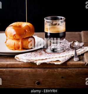 Donuts and coffee on textured background - Stock Photo