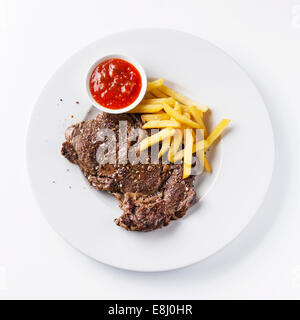 Roast beef with Salted french fries on white plate on white background - Stock Photo