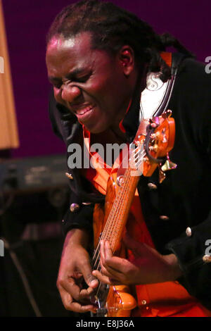 Moscow, Russia. 8th Oct, 2014. Cameroonian bassist Richard Bona performs at the Moscow International House of Music. - Stock Photo