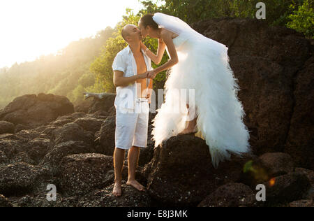 The love story of a beautiful young couple on the beaches of Goa, on the shores of the Indian Ocean - Stock Photo