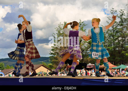 Girls in a Highland Dancing competition at the Highland Games, Dufftown, Moray, Highlands, Scotland, United Kingdom - Stock Photo