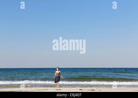 Woman on the beach, Baltic Sea resort of Ahrenshoop, Fischland-Darß-Zingst, Bodden Landscape of Vorpommern National - Stock Photo