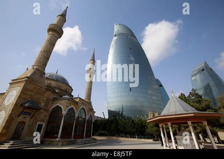 Shehidler mosque and flame towers, Baku - Stock Photo