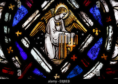 The American church in Paris. Stained glass window.  The angel symbol of Matthew. - Stock Photo