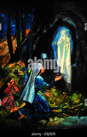 Depiction of the first Marian apparition of our Lady of Lourdes to Bernadette Soubirous in the french city of Lourdes. - Stock Photo