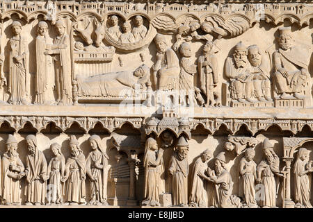 Notre Dame de Paris cathedral.  Western facade. St Anne portal. Life of the Virgin Mary. - Stock Photo
