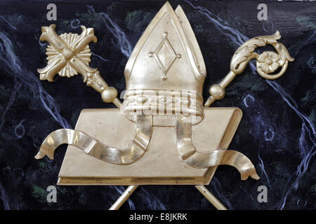 Symbols of the bishop : miter, crozier and gospel. - Stock Photo