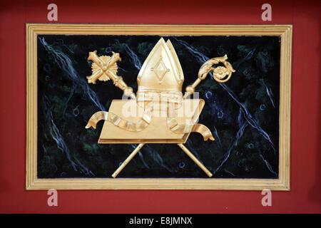 Symbols of the bishop : miter, crozier and gospel. - Stock Photo