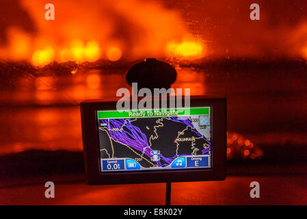 GPS with the Holuhraun Fissure Eruption in the background, Northern Iceland. - Stock Photo