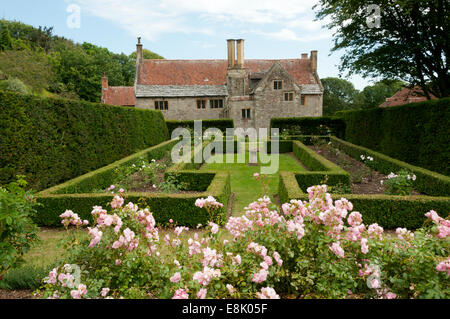 Mottistone Manor on the Isle of Wight, seen across the formal rose garden. - Stock Photo