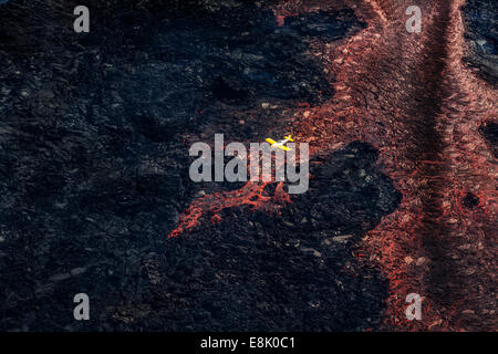 Plane flying over the Volcano Eruption site at the Holuhraun Fissure, by the Bardarbunga Volcano, Iceland. - Stock Photo