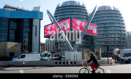 London, UK. 9th October, 2014.   In autumn sunshine a cyclist navigates the Old Street 'Silicon' roundabout at midday - Stock Photo