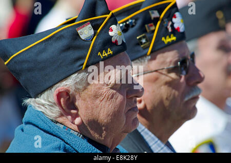World War II Army Veterans give their attention during a speech dedicating a statue to honor the Veterans of World - Stock Photo