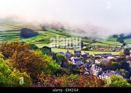 Misty Autumn morning, with low cloud, over the town of Settle, North Yorkshire, UK - Stock Photo