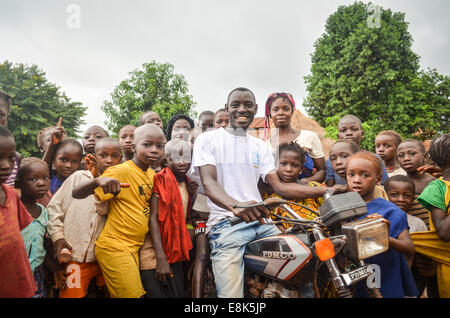 African children in a village in the east of Guinea, near the border with Sierra Leone - Stock Photo