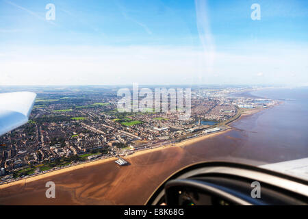 Cleethorpes pier & Grimsby aerial view town houses homes coast coastal coastline Humber estuary river from above - Stock Photo