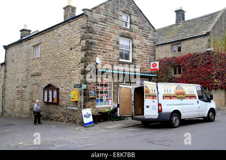 The village shop and Post Office taking delivery in the village of Winster in the Peak district National park, Derbyshire, - Stock Photo