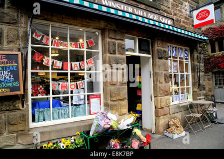 The village shop and Post Office on the Main Street at Winster in the Peak district National park, Derbyshire, England, - Stock Photo