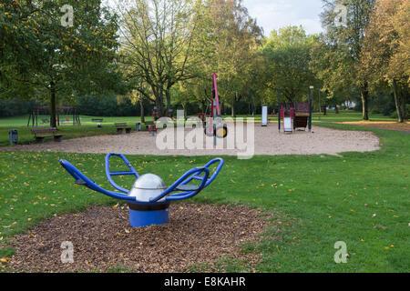 An empty children's playground in the autumn - Stock Photo