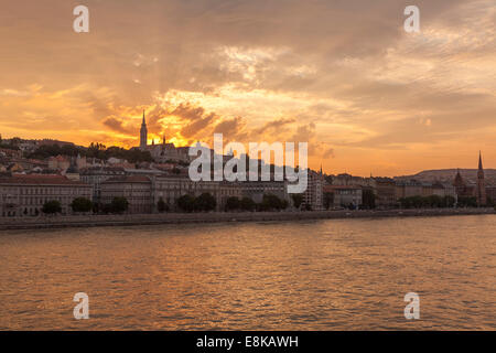 Sunset over Buda district, with Mathias Church and Fisherman's Bastion,Budapest,Hungary - Stock Photo