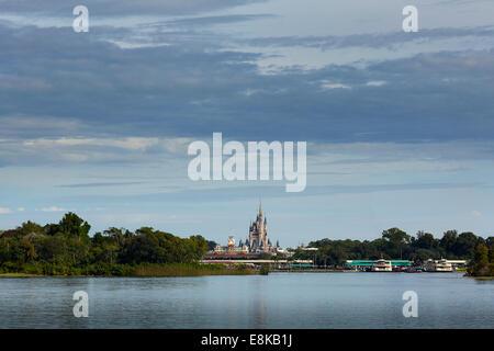 Florida USA Disney land lake, view of disney castle from across the lake - Stock Photo