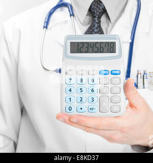 Doctor holdling calculator - heath care concept - 1 to 1 ratio - Stock Photo