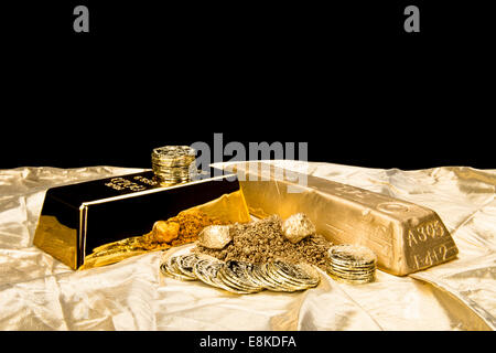 Gold in various forms including dust, nuggets, bar, ingot and coins isolated on a black background for placement - Stock Photo