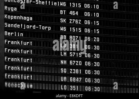 Close up view of airport time-table unique background with departure and arrivals - Stock Photo