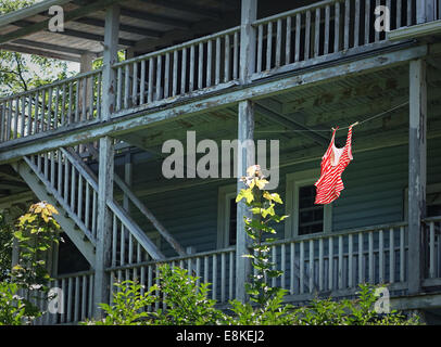 bathing suit on clothesline behind tenement residence - Stock Photo