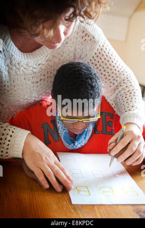 Reportage on Sylvain, 11 years old, suffering from autism He was diagnosed when he was 7 Sylvains mother trained - Stock Photo