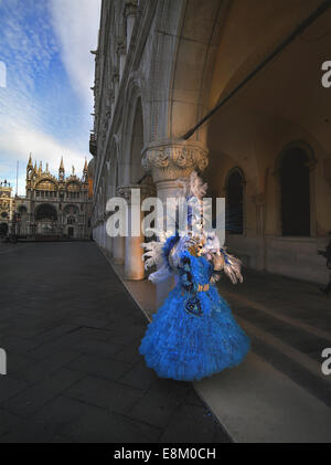 Unidentified man and woman in carnival masks on the area of the Doge of Venice - Stock Photo
