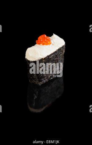 Gunkan Maki Sushi with Cream Cheese on a black background - Stock Photo