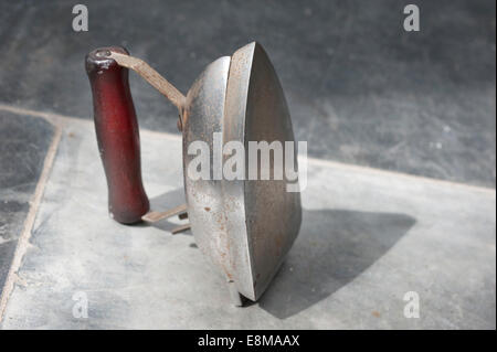 Picture by Roger Bamber : 30 June 2010 : An old battered portable small electric travelling Iron bought to celebrate - Stock Photo