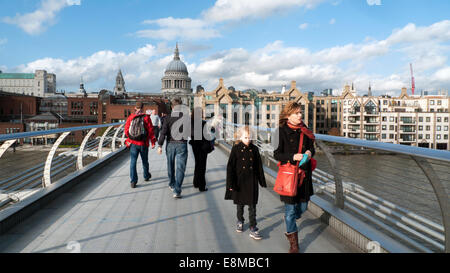People walk across the Millennium Bridge over the River Thames in on a sunny autumn day in London England UK  KATHY - Stock Photo