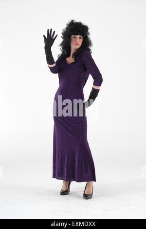 Woman in fancy dress comedy costume in a purple dress - Stock Photo